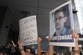 Snowden gains support from protesters in hong kong several hundred demonstrators took to kongs streets the rain saturday voicing Stock Image