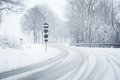Snowfall on a curvy country road sudden and heavy driving it becomes dangerous … Stock Photos