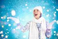 Snowfall joyful girl in winterwear enjoying Stock Image
