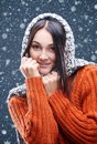 Snowfall snowflakes fall on the head of a young girl Royalty Free Stock Image