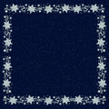 Snowflake backgound on navy blue background with snowfalling and border of snowflakes background Stock Photos