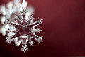 Snowflake ornament on red background Stock Photo