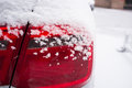Snowflake snow cover in the car taillights closeup Royalty Free Stock Photo