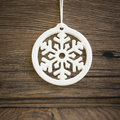 Snowflake on a wooden background Stock Photos
