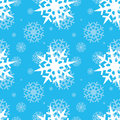 Snowflakes on blue sky christmas seamless background Royalty Free Stock Photography