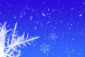 Snowflakes a blue winter sky with and ice crystals Stock Photos