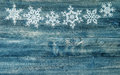 Snowflakes border over rustic wooden background. winter holidays Royalty Free Stock Photo