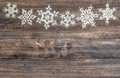 Snowflakes border over wooden background. christmas decoration Royalty Free Stock Photo