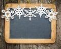 Snowflakes border on wood blackboard blank Royalty Free Stock Photo