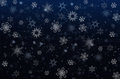 Snowflakes on a dark blue background Royalty Free Stock Photo