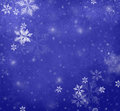 Snowflakes falling on blue Christmas background, winter background Royalty Free Stock Photo