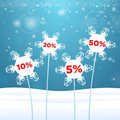 Snowflakes in the form of flowers with sale outdoors Royalty Free Stock Photography
