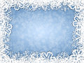 Snowflakes frame on frosty background