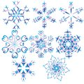 Snowflakes are poured by different colours Royalty Free Stock Photos