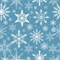 Snowflakes seamless pattern. Frosty repeating texture. Christmas and New Year infinite background. Vector illustration. Royalty Free Stock Photo