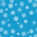 Snowflakes seamless pattern. Holiday blue background. Christmas vector illustration. Royalty Free Stock Photo