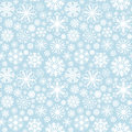Snowflakes seamless pattern made of white illustrated on blue background Royalty Free Stock Photos