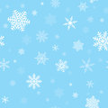 Snowflakes seamless pattern repeating of white on a blue background Royalty Free Stock Photos