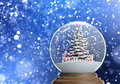 Snowglobe with christmas tree and presents inside Stock Photography