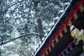 Snowing chinese eaves in winter Royalty Free Stock Photo