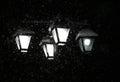 Snowing january night.street chandelier lights