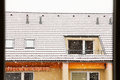 Snowing over the contemporary apartment house Royalty Free Stock Image