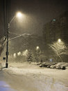 Snowing in a sleepy town snow coming down at night Stock Photo