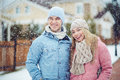 Snowing winter young couple standing while itâ s Stock Images