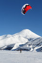 Snowkiting sportsman glides on skis on background volcano kamchatka avacha russia november kiteboarding or snow a of active Stock Image