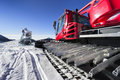 Snowmaking Gun And Snow Groomer On Ski Slopes