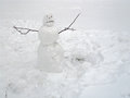 Snowman against white snow background winter time Stock Image