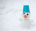 Snowman with blue bucket Royalty Free Stock Photography
