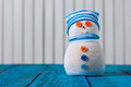 Snowman on blue wooden background. With empty Royalty Free Stock Photo