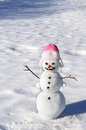 Snowman with carrot nose and coal eyes mouth on snowy field Stock Photos