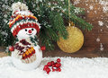 Snowman with Christmas tree on a wooden background Royalty Free Stock Photo