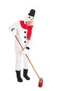 Snowman cleaning the street human is with broom Royalty Free Stock Photos