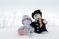 Snowman couple cuddle in the snow a whimsical pair of people enjoy an outing Stock Images