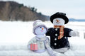 Snowman couple enjoy the outdoors a whimsical pair of snow people an outing in snow Royalty Free Stock Photography