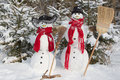 Snowman couple in winter - christmas outdoor decoration with snow