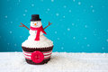 Snowman cupcake decorated with a fondant Royalty Free Stock Images