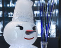 Snowman decorative smiling made of glass as a decoration for a glass store shop during christmas time Stock Photos