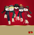 Snowman family  on red background Royalty Free Stock Photography