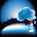 Snowman in front of a tree Stock Photography