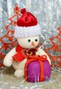 Snowman and gift Stock Images