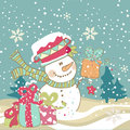Snowman with gifts Royalty Free Stock Images