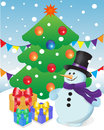 Snowman and gifts at Christmas tree Royalty Free Stock Image