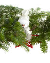 Snowman hidden in pine branches Royalty Free Stock Photography