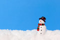 Snowman a model on real snow against a plain blue background add your own text Stock Images