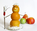 Snowman from oranges with broom and cream Royalty Free Stock Photo