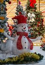 Snowman with red heat and decorations Royalty Free Stock Photo